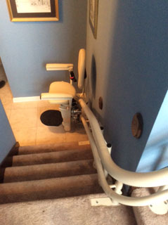 Merrett Stairlifts - Helix stairlift at bottom of stairs