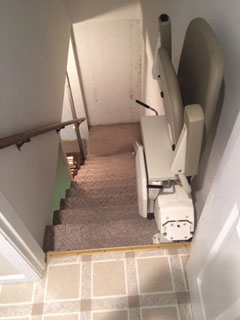 Merrett Stairlifts - Pinnacle stairlift folded at top of stairs