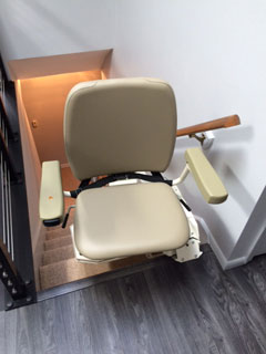 Merrett Stairlifts - Pinnacle stairlift at top of stairs